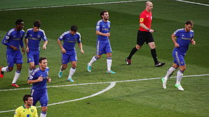 Chelsea players returning to their half.jpg