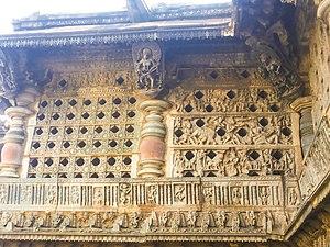 Chennakeshava Temple, Belur - Two styles of light screens used in Kesava temple: geometric artwork (left) and Puranic stories artwork.