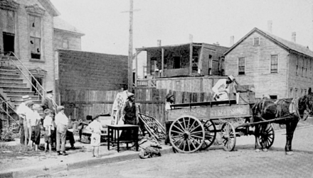 Du Bois documented the 1919 Red Summer race riots. This family is evacuating their house after it was vandalized in the Chicago race riot. ChicagoRaceRiot 1919 wagon.png