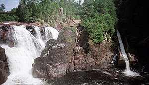 Chute (gravity) - Natural chute (falls) on the left and man-made logging chute on the right on the Coulonge River in Quebec, Canada.