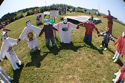 Circle of scarecrow children at Joe's Scarecrow Village.JPG