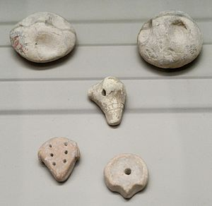 Bulla (seal) - Clay accounting tokens used inside of a bulla