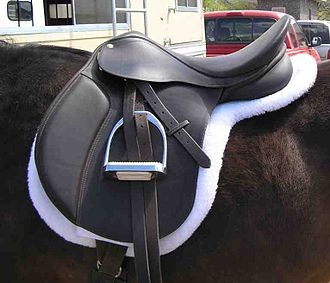 "Hunt seat - One style of hunt seat saddle, an ""eventing"" saddle. It is heavier and has a deeper seat than the ""close contact"" style of hunt seat saddle."