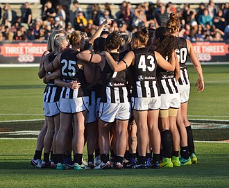 Collingwood Football Club - The Collingwood team huddles prior to the inaugural AFL Women's match in February 2017.