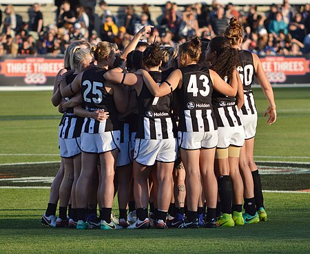 The Collingwood team huddles prior to the inaugural AFL Women's match in February 2017. Collingwood AFLW 03.02.17.jpg