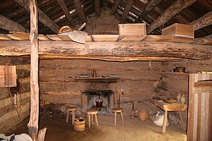Interior of a recreated log cabin.