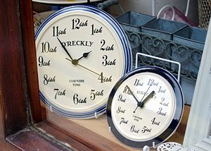 "Anglo-Cornish - ""D'reckly"" on souvenir clocks in Cornwall"