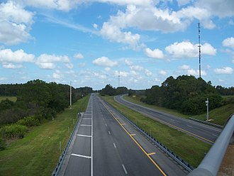 Florida's Turnpike - Florida's Turnpike looking northbound from the overpass on Canoe Creek Road, with the Canoe Creek service plaza visible