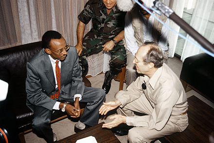 William J. Perry, the U.S. Defense Secretary from 1994 to 1997, speaks with Rwandan dictator Paul Kagame. Perry helped secure the delivery of weapons to Kagame that were used to attack Congo and exterminate Hutu refugees in eastern Congo.