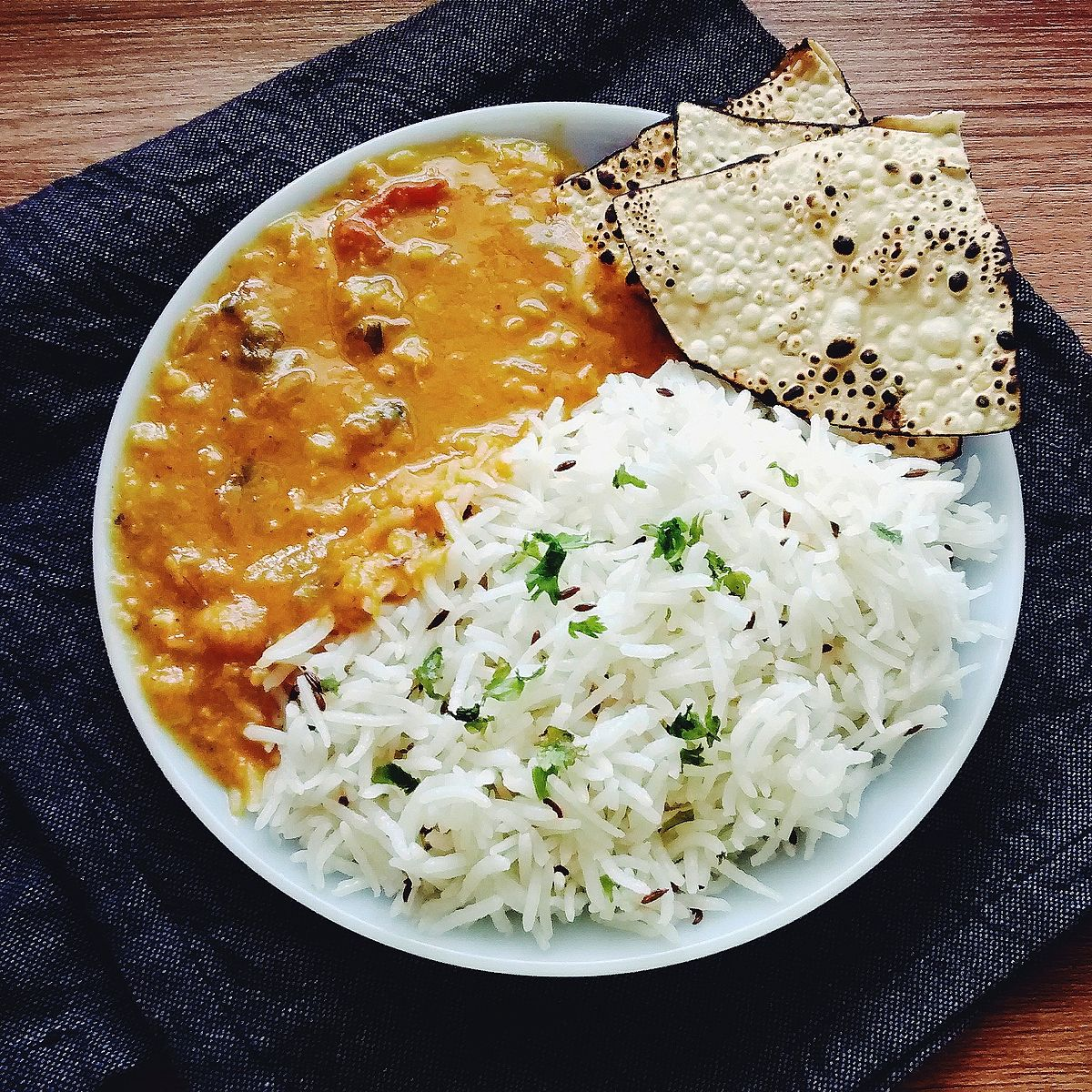 Dal Fry Tadka, Cumin Rice, Roasted Papad on the side.jpg