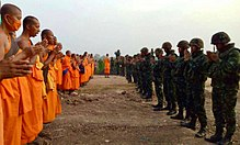 Dhammakaya monks chanting with soldiers.jpg