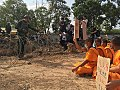 Dhammakaya monks sit and picket soldiers.jpg