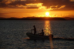 Dinghy crossing as the sun set.jpg