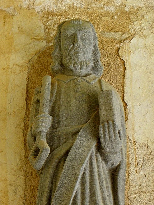 The statue of Saint Peter with key and book in the south porch of the Église Sainte-Nonne.
