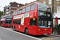 Docklands Buses E218 & E217 on Route 135, Stepney Arbour Square (17451484524).jpg