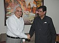 E. Ahamed meeting the Union Minister for Human Resource Development and Communications and Information Technology, Shri Kapil Sibal, in New Delhi on July 13, 2011.jpg