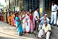 Elderly voters along with other voters are eagerly waiting outside a polling booth to cast their votes, during the 7th Phase of General Elections-2014, at Uluberia Parliamentary Constituency, West Bengal on April 30, 2014.jpg