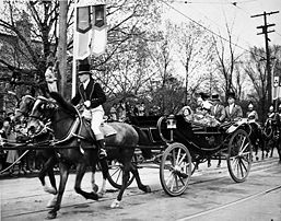 George VI and Queen Elizabeth in a landau with footmen and an outrider, Canada 1939