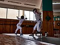 Epee fencing at Athenaikos Fencing Club. The fencers Eleftheria Mimigianni and Aris Koutsouflakis.jpg
