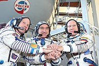 Expedition 37 backup crew members in front of the Soyuz TMA spacecraft mock-up in Star City, Russia.jpg