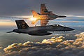 F-A-18 Super Hornets deploy heat flares during a combat patrol over Afghanistan.jpg