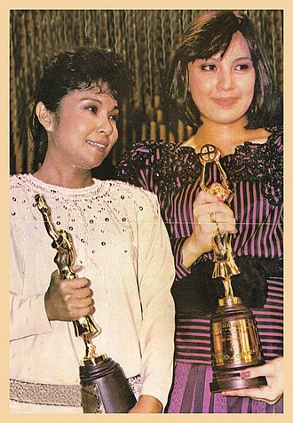 Nora Aunor - Aunor and Sharon Cuneta at the 33rd FAMAS Awards both won the coveted Best Actress Award in 1985
