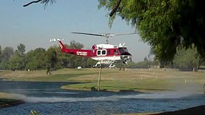 Carbon Canyon Regional Park - An OCFA helicopter extracting water from the lake in the park.