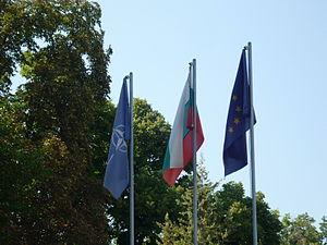 Enlargement of NATO - Flags of NATO, Bulgaria, European Union at the Military club of Plovdiv, Bulgaria