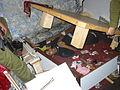Flickr - Israel Defense Forces - Suicide Bomb Planner Found Hiding Under Bed (1).jpg