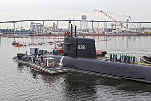 USS Daniel Webster (SSBN-626) - The moored training ship Daniel Webster (MTS-626) being towed from Norfolk Naval Shipyard to Charleston, South Carolina, after undergoing a maintenance availability (27 August 2012)