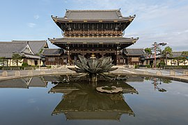 Founder's Hall gate of Higashi-Honganji Temple, with water reflection, Kyoto, Japan.jpg