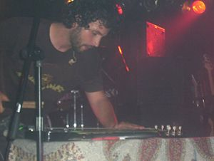 Dredg - Lead singer Gavin Hayes playing the slide guitar at The Masquerade in Atlanta, Georgia on May 24, 2005.