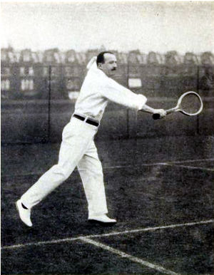 George Caridia - George Aristides Caridia, English tennis player, making a backhand (before 1908)