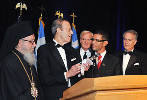National Endowment for Democracy - The President of the National Endowment for Democracy, Carl Gershman (pictured, second from the left), presents an award to a Tunisian leader of the Arab Spring in November 2011.