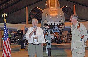 Nelson F. Gibbs - Gibbs speaking at Bagram Airfield while Lt. Gen. Walter E. Buchanan III, Commander of the Ninth Air Force, looks on.