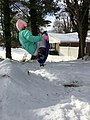 Girl Jumping on Snow Saucer.jpg