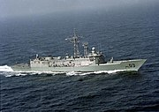 Aerial view of a frigate travelling at speed.