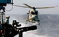 HMS St Albans' Merlin Helicopter Returns to the Ship Near Gibraltar MOD 45151070.jpg