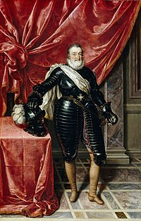 Portrait of Henry the IV of France. He is dressed in all black standing in front of a red curtain.