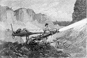 Water cannon - A miner using a hydraulic jet to mine for gold in California, from The Century Magazine January 1883