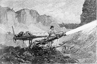 Hydraulic mining - A miner using a hydraulic jet to mine for gold in California, from The Century Magazine January 1883