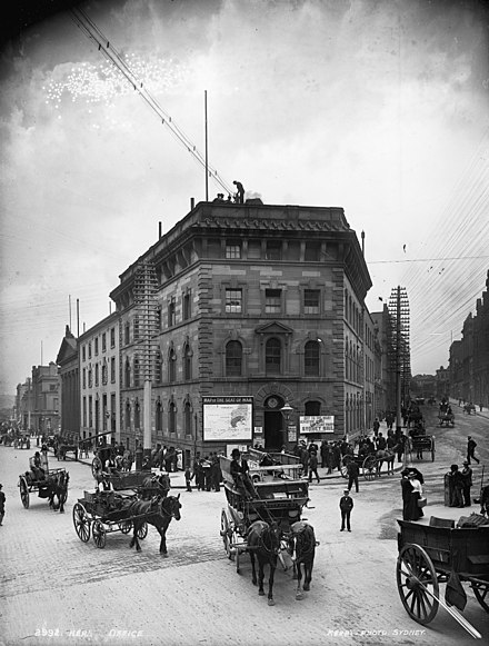 Sydney Morning Herald building on the corner of Pitt and Hunter Streets, built 1856, demolished in the 1920s for a larger building Herald Office, Sydney (3003586345).jpg