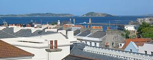 Little Roussel - A view from the rooftops of St Peter Port across the Little Russel to Herm and Jethou