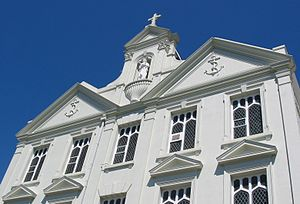 Highlands College, Jersey - Anchors on the façade and a statue of the Madonna and Child show the college's past as a naval college and Catholic institution