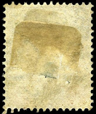 Postage stamp gum - Multiple hinge remnants are visible on the back of this stamp.