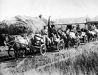 "Holodomor - A ""Red Train"" of carts from the ""Wave of Proletarian Revolution"" collective farm in the village of Oleksiyivka, Kharkiv oblast in 1932. ""Red Trains"" took the first harvest of the season's crop to the government depots. During the Holodomor, these brigades were part of the Soviet Government's policy of deliberately taking away food from the peasants."