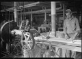 Holyoke, Massachusetts - Paragon Rubber Co. and American Character Doll. Tubing - cutting rubber and feeding... - NARA - 518340.tif