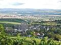 Holzachterbahn Mammut im Erlebnispark Tripsdrill, im Hintergrund Kernkraftwerk Neckarwestheim - panoramio.jpg
