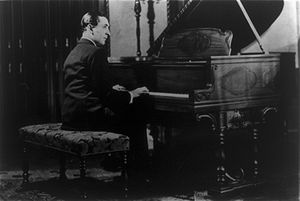 Vladimir Horowitz seated at the piano.