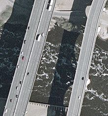 closeup aerial of a section of the bridge next to a section of the 10th Avenue bridge